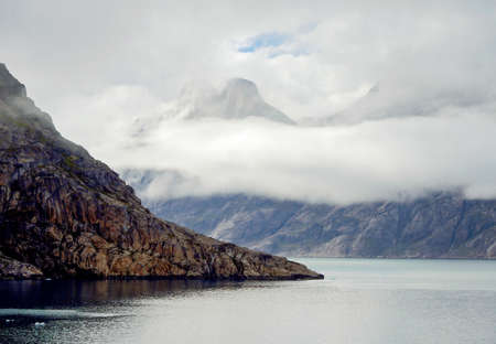 climatic: Prince Christian Sound in Greenland, black mood with overcast mountains