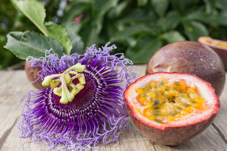 passion fruit flower: Passion fruit with blossom on a wooden table
