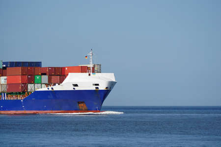 ship bow: The bow of a cargo ship with many containers