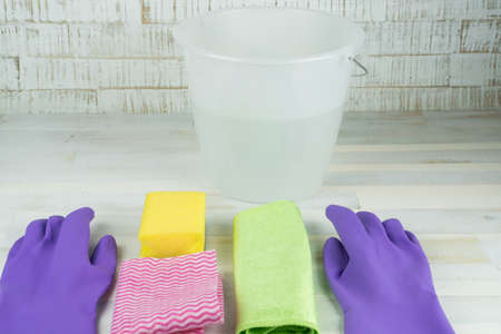 Spring cleaning, rubber gloves, bucket, sponge and cleaning rag Stock Photo