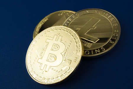 Bitcoin, ethereum and litecoin on blue background