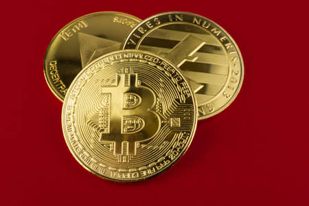 Bitcoin, ethereum and litecoin on red background