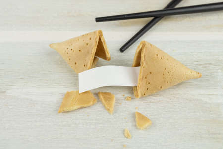 Fortune cookie with chopsticks Stock Photo