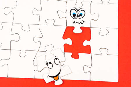 puzzle pieces two of them with funny face