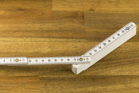 White measure on wooden background Stockfoto