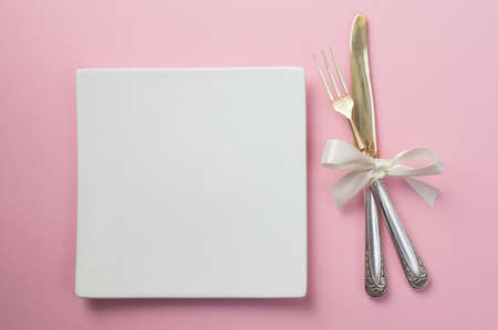 Silver fork and knife on white background