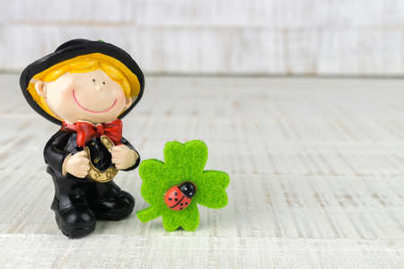 Little chimney sweeper with four leaf clovers and lady bugs 写真素材