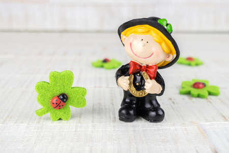 Little chimney sweeper with four leaf clovers and lady bugs Stock fotó