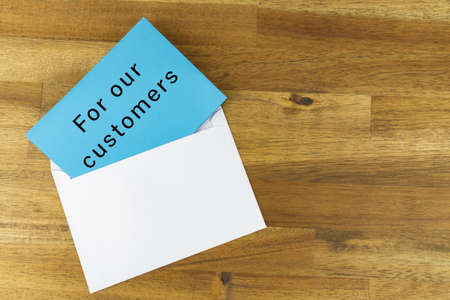 Envelope with a blue note with the words FOR OUR CUSTOMERS