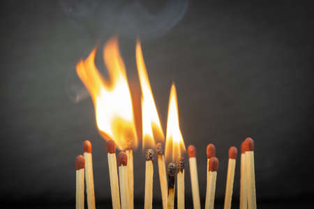 A group of matches, some of which are burning