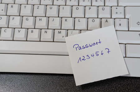 Note with the german word for password on a computer keyboard