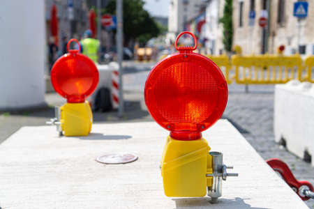 Two signal lamps in the city