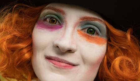 Portrait of a beautiful young woman with red hair and colorful make-up Zdjęcie Seryjne