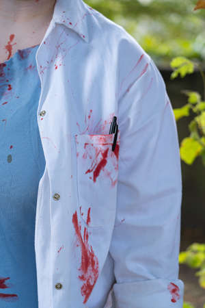 Bloodied clothes of a woman Imagens