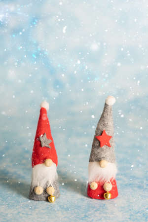 Two little Christmas gnome with pointed hats Standard-Bild - 137968982