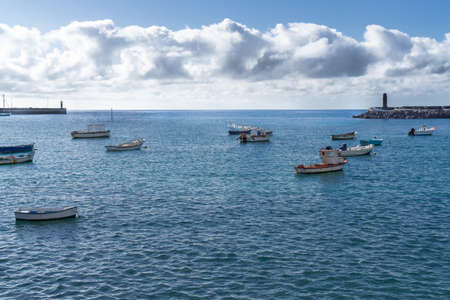 many small fishing boats and row boats in the water