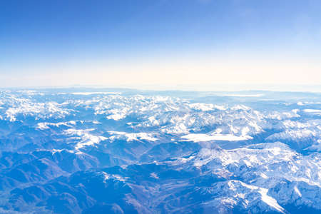 Flight over the snow capped mountains of the Pyrenees