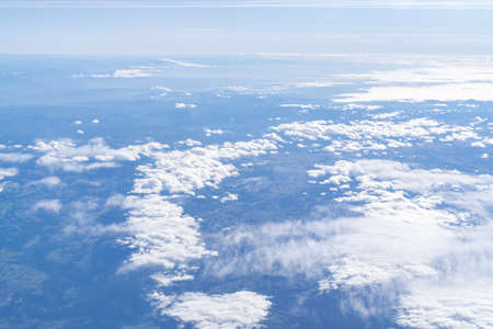 Flight over the clouds with blue sky and sunshine