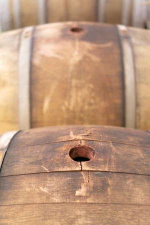 old wooden wine barrels in a wine press