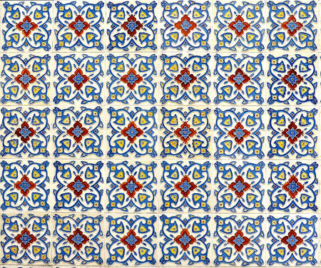 Geometric floral tile mosaic in blues and reds. Typical of the designs and patterns typically found on the facade of traditional Chinese Peranakan shop houses.