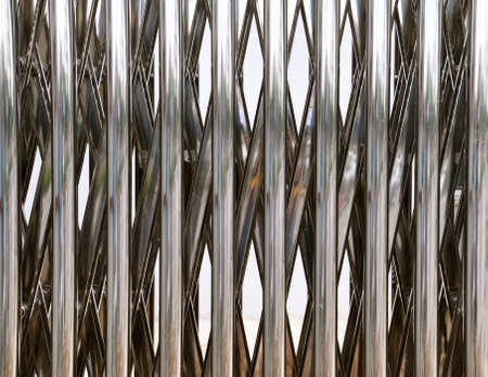 Close up view of a stainless steel cantiliever extendable door.