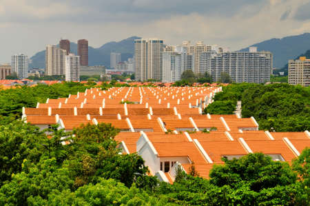 Perspective view of roof tops of housing with a background of tall apartments. 写真素材