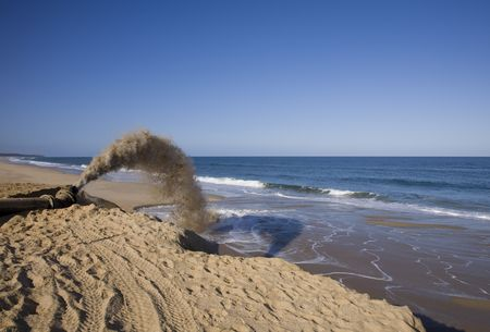 preserve: sand discharging from pipeline to preserve beach
