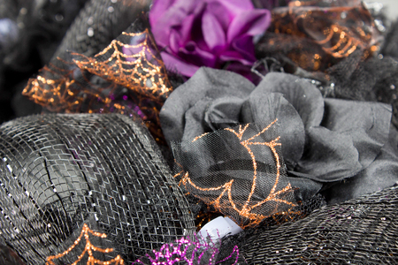 hand made halloween wreath crafted from black and spider web design mesh