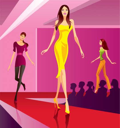 Modelos de moda que representa una colección en la revisión