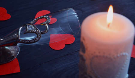 Burning candle, romantic atmosphere. On a wooden board. Valentine's Day. Valentine
