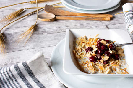 Oatmeal with roasted almonds cherries
