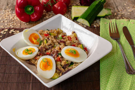 hearty porridge with vegetables and boiled eggs