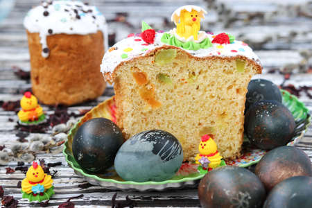 Easter eggs painted karkade tea, Easter cakes on a plate, spring still life