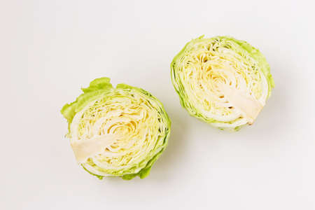 Cabbage halves are located on a white background, top view Zdjęcie Seryjne
