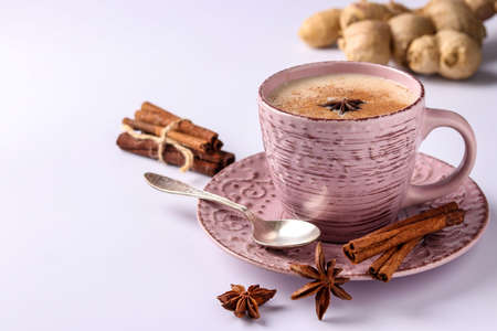 Traditional indian drink - masala tea with spices on a white background, horizontal orientation, copy space, close-up