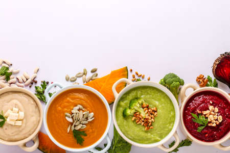 Variety of colorful vegetables cream soup: with broccoli, beets, white beans and pumpkins, healthy eating concept, Copy space, Top view, Horizontal orientation
