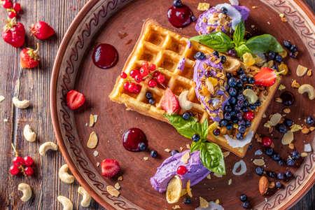 Belgian waffles with blueberry cream, granola and fresh berries, Tasty breakfast, Horizontal orientation, Closeup, Top view