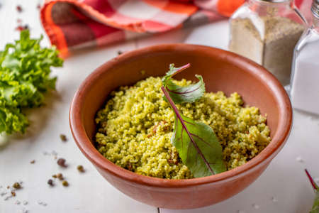 Couscous in bowl with olive oil and dried tomatoes on white background, oriental cuisine, horizontal orientation, closeup Stok Fotoğraf