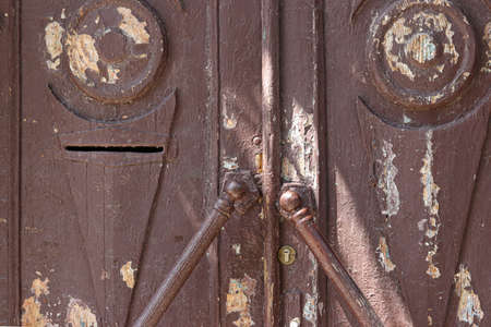 Old shabby brown wooden door with handle, Closeup, Rural country background, Horizontal orientation Stock fotó