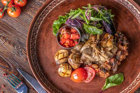 Mushroom garnish with vegetable and tomato salsa, vegetarian food, restaurant dish, Close up, Horizontal orientation, Top view 版權商用圖片