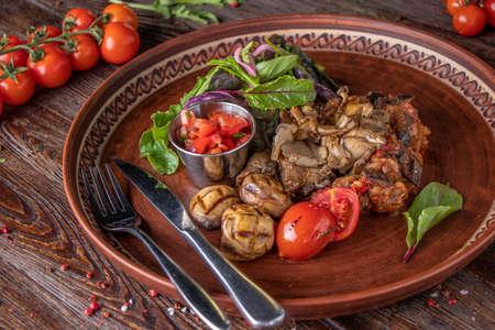 Mushroom garnish with vegetable and tomato salsa, vegetarian food, restaurant dish, Close up, Horizontal orientation