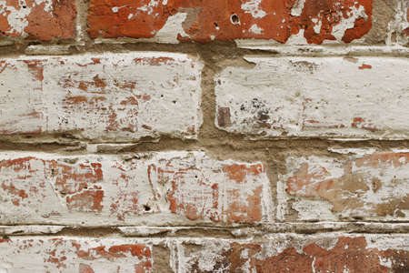 Old brick wall with cracked blue paint copy space for design or text, horizontal format