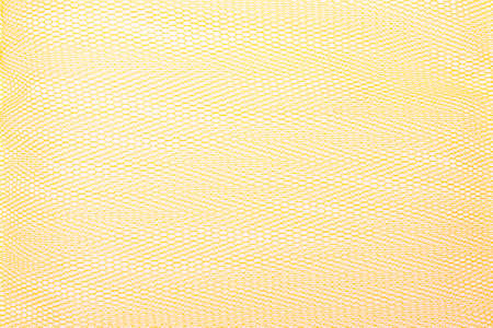 enmesh: yellow tulle netting as a background