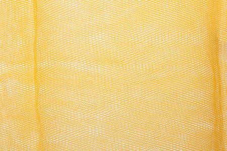 enmesh: orange wire-gauze as a background