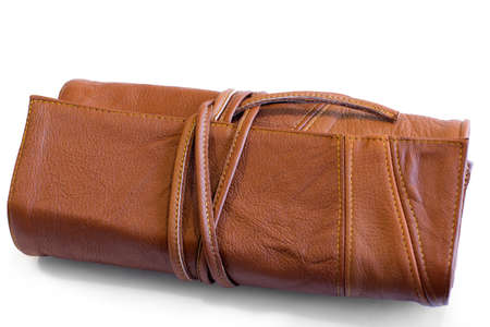 clutch cover: rufous leather purse or clutch on ties  Stock Photo