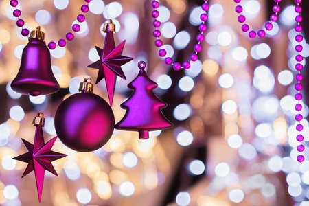 magentas: Christmas decoration from magentas Christmas toys and beads on a background with boken