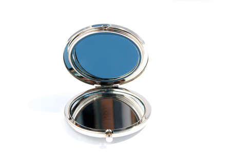 Small round glass mirror isolated on a white background Stock Photo