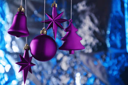 magentas: Christmas decoration from magentas Christmas toys on a blue background with boken