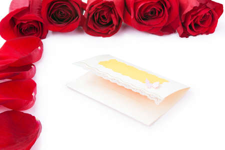frame of red roses around blank gift cards on a white background