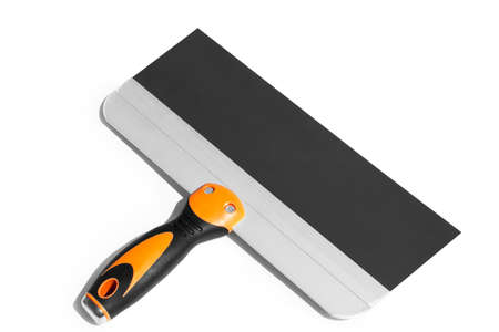 putty knife with black and orange rubber handle on the white background isolated